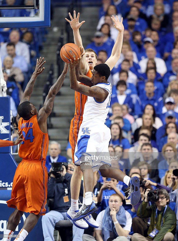 Archie Goodwin #10 of the Kentucky Wildcats shoots the ball while defended by Erik Murphy #33 of the Florida Gators during the game at Rupp Arena on March 9, 2013 in Lexington, Kentucky.