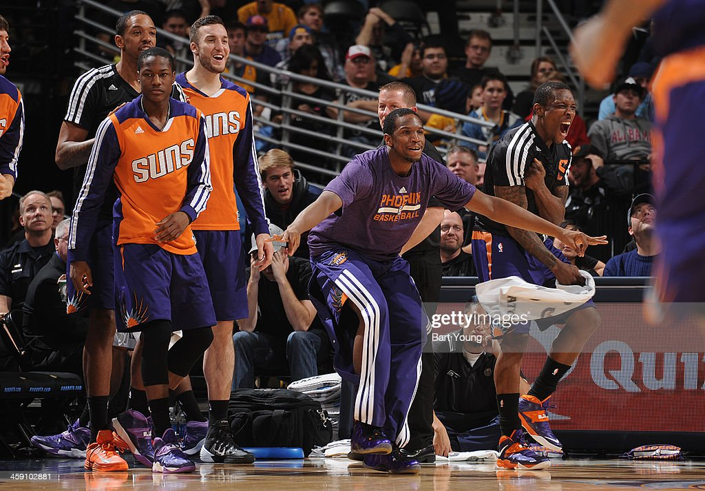 <a gi-track='captionPersonalityLinkClicked' href=/galleries/search?phrase=Archie+Goodwin&family=editorial&specificpeople=9086088 ng-click='$event.stopPropagation()'>Archie Goodwin</a> #20 of the Phoenix Suns celebrates from the bench against the Denver Nuggets on December 20, 2013 at the Pepsi Center in Denver, Colorado.