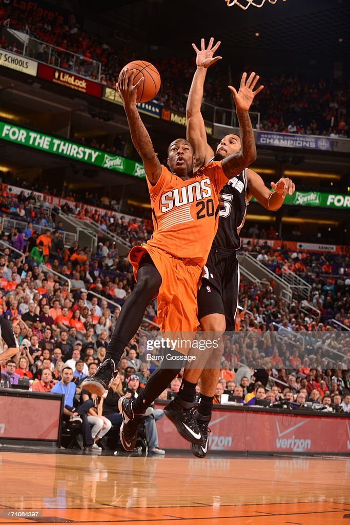 Archie Goodwin #20 of the Phoenix Suns drives for a shot against Cory Joseph #5 of the San Antonio Spurs on February 21, 2014 at U.S. Airways Center in Phoenix, Arizona.