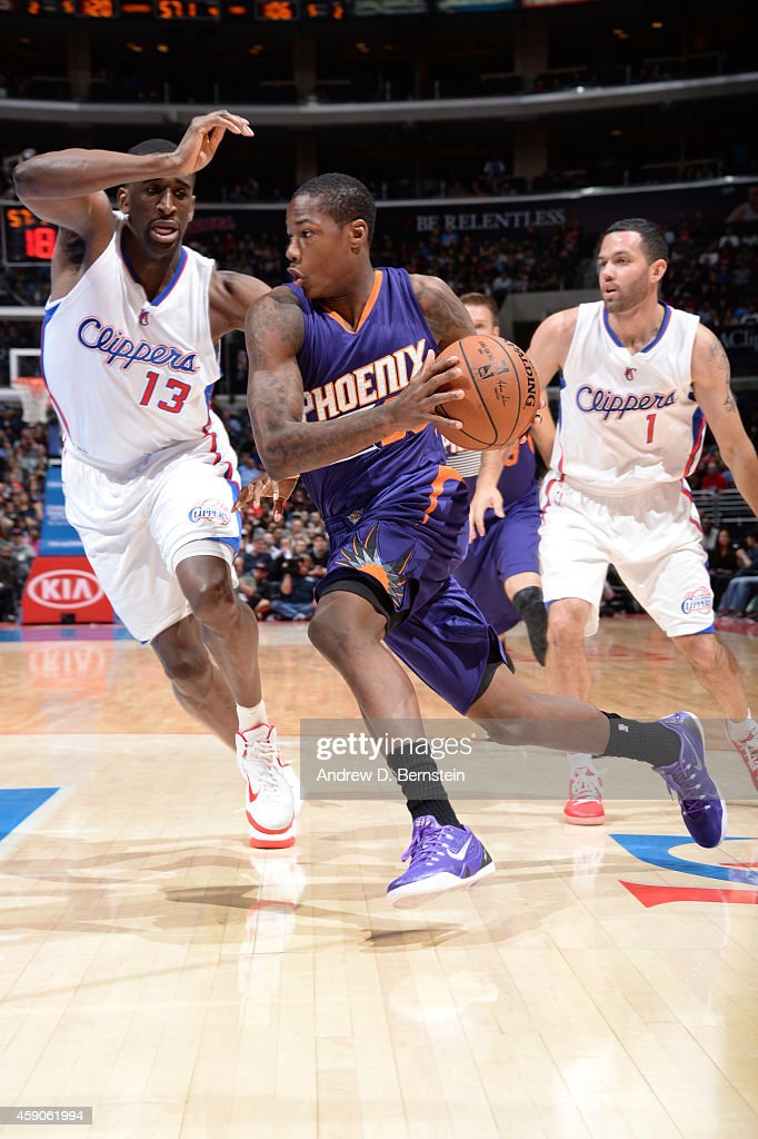 <a gi-track='captionPersonalityLinkClicked' href=/galleries/search?phrase=Archie+Goodwin&family=editorial&specificpeople=9086088 ng-click='$event.stopPropagation()'>Archie Goodwin</a> #20 of the Phoenix Suns drives to the basket against <a gi-track='captionPersonalityLinkClicked' href=/galleries/search?phrase=Ekpe+Udoh&family=editorial&specificpeople=4185351 ng-click='$event.stopPropagation()'>Ekpe Udoh</a> #13 of the Los Angeles Clippersduring the game on November 15, 2014 at STAPLES CENTER in Los Angeles, California.