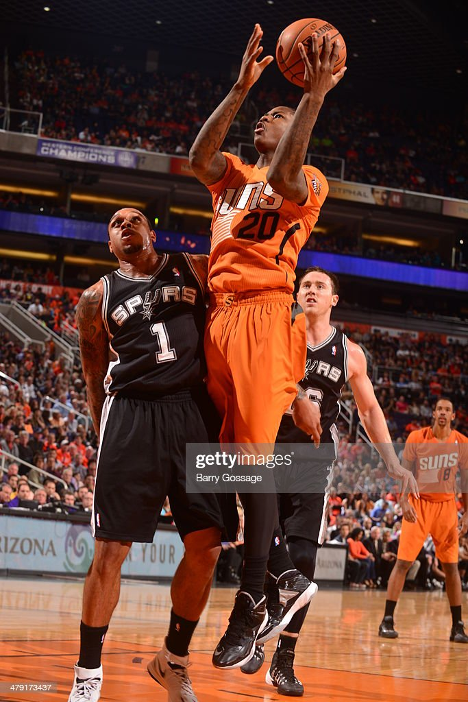 Archie Goodwin #20 of the Phoenix Suns drives to the basket against the San Antonio Spurs on February 21, 2014 at U.S. Airways Center in Phoenix, Arizona.