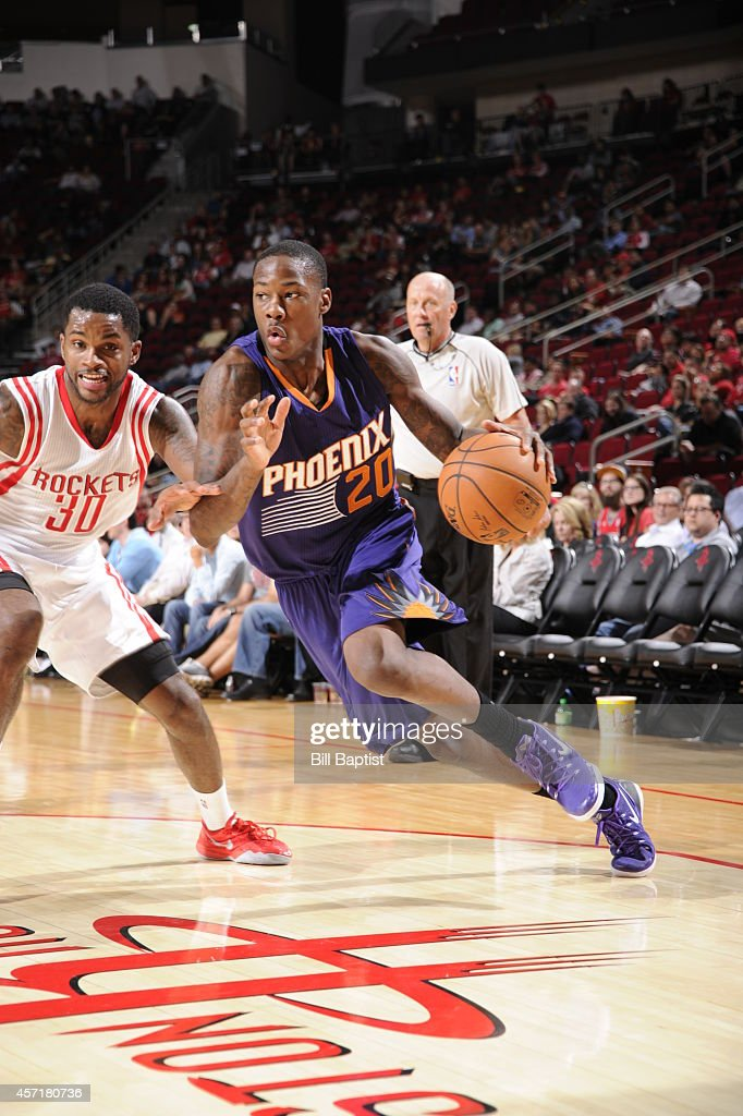 Archie Goodwin #20 of the Phoenix Suns handles the ball against the Houston Rockets on October 13, 2014 at the Toyota Center in Houston, Texas.
