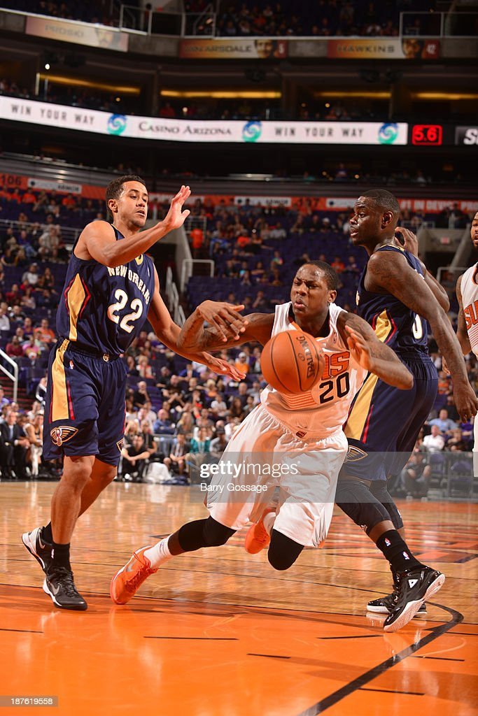 <a gi-track='captionPersonalityLinkClicked' href=/galleries/search?phrase=Archie+Goodwin&family=editorial&specificpeople=9086088 ng-click='$event.stopPropagation()'>Archie Goodwin</a> #20 of the Phoenix Suns is tripped up driving between Brian Roberts #22 and <a gi-track='captionPersonalityLinkClicked' href=/galleries/search?phrase=Anthony+Morrow&family=editorial&specificpeople=814354 ng-click='$event.stopPropagation()'>Anthony Morrow</a> #3 of the New Orleans Pelicans on November 10, 2013 at U.S. Airways Center in Phoenix, Arizona.
