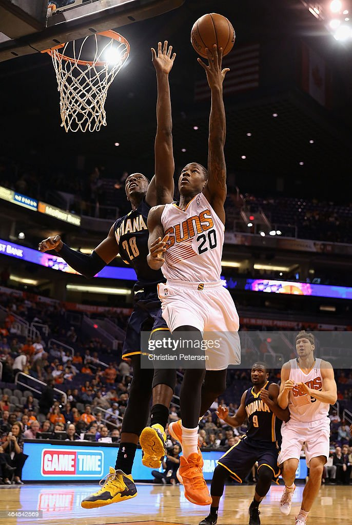 <a gi-track='captionPersonalityLinkClicked' href=/galleries/search?phrase=Archie+Goodwin&family=editorial&specificpeople=9086088 ng-click='$event.stopPropagation()'>Archie Goodwin</a> #20 of the Phoenix Suns lays up a shot past <a gi-track='captionPersonalityLinkClicked' href=/galleries/search?phrase=Ian+Mahinmi&family=editorial&specificpeople=740196 ng-click='$event.stopPropagation()'>Ian Mahinmi</a> #28 of the Indiana Pacers during the second half of the NBA game at US Airways Center on January 22, 2014 in Phoenix, Arizona. The Suns defeated the Pacers 124-100.