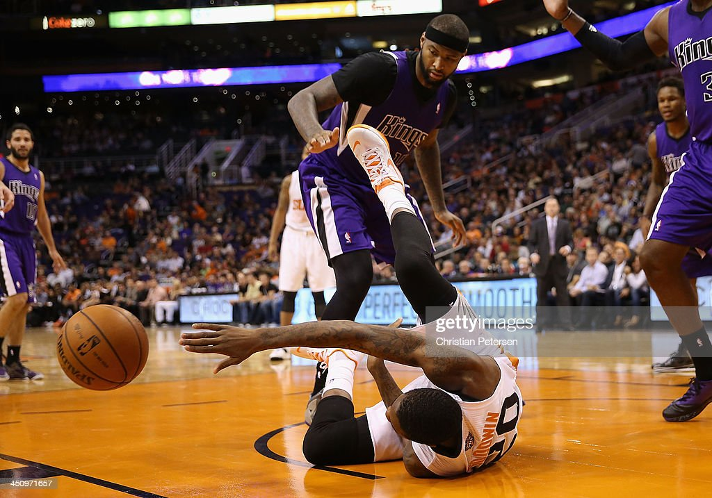 <a gi-track='captionPersonalityLinkClicked' href=/galleries/search?phrase=Archie+Goodwin&family=editorial&specificpeople=9086088 ng-click='$event.stopPropagation()'>Archie Goodwin</a> #20 of the Phoenix Suns passes the ball while on the court during the second half of the NBA game against the Sacramento Kings at US Airways Center on November 20, 2013 in Phoenix, Arizona. The Kings defeated the Suns 113-106.