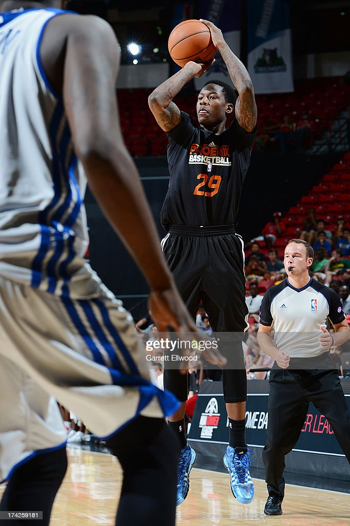 <a gi-track='captionPersonalityLinkClicked' href=/galleries/search?phrase=Archie+Goodwin&family=editorial&specificpeople=9086088 ng-click='$event.stopPropagation()'>Archie Goodwin</a> #29 of the Phoenix Suns shoots the ball against the Golden State Warriors during NBA Summer League Championship Game on July 22, 2013 at the Cox Pavilion in Las Vegas, Nevada.