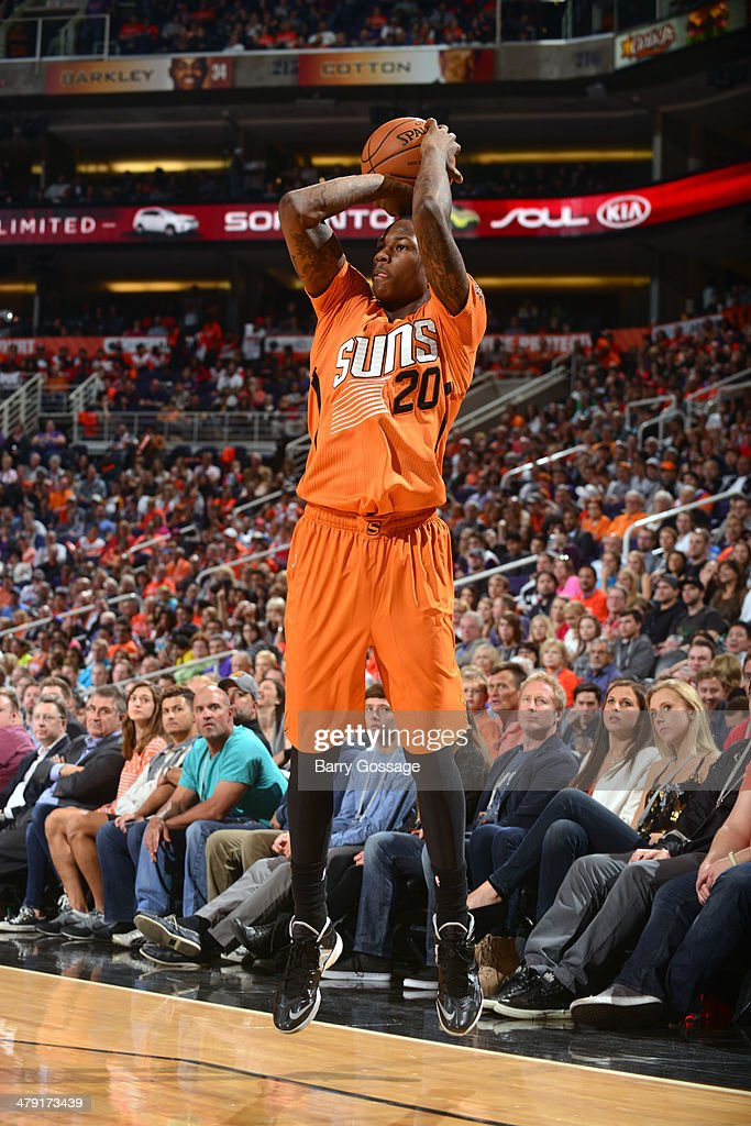<a gi-track='captionPersonalityLinkClicked' href=/galleries/search?phrase=Archie+Goodwin&family=editorial&specificpeople=9086088 ng-click='$event.stopPropagation()'>Archie Goodwin</a> #20 of the Phoenix Suns shoots the ball against the San Antonio Spurs on February 21, 2014 at U.S. Airways Center in Phoenix, Arizona.
