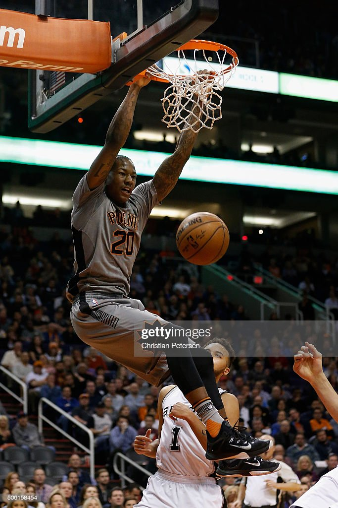 <a gi-track='captionPersonalityLinkClicked' href=/galleries/search?phrase=Archie+Goodwin&family=editorial&specificpeople=9086088 ng-click='$event.stopPropagation()'>Archie Goodwin</a> #20 of the Phoenix Suns slam dunks the ball against the San Antonio Spurs during the first half of the NBA game at Talking Stick Resort Arena on January 21, 2016 in Phoenix, Arizona.
