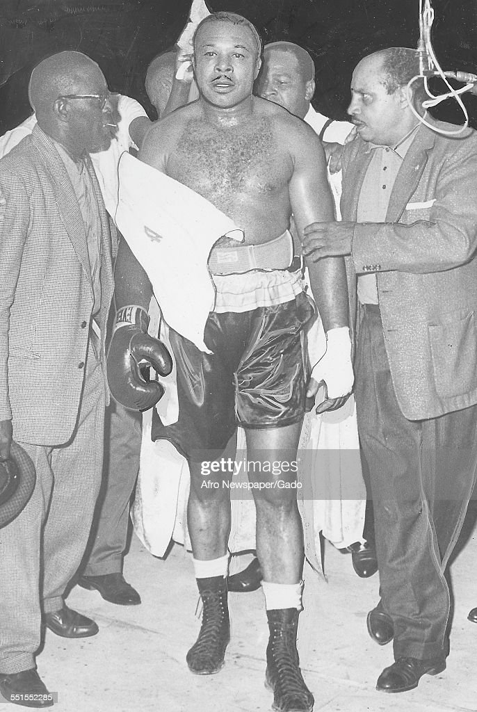 <a gi-track='captionPersonalityLinkClicked' href=/galleries/search?phrase=Archie+Moore&family=editorial&specificpeople=93092 ng-click='$event.stopPropagation()'>Archie Moore</a>, African-American professional boxer and the Light Heavyweight World Champion, being escorted from the ring in the match with Pete Redemacher, October 28, 1961.