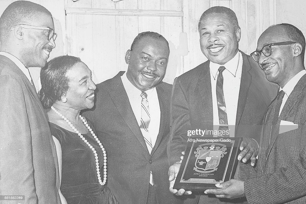 <a gi-track='captionPersonalityLinkClicked' href=/galleries/search?phrase=Archie+Moore&family=editorial&specificpeople=93092 ng-click='$event.stopPropagation()'>Archie Moore</a>, African-American professional boxer and the Light Heavyweight World Champion, being given an award for social and sporting achievements, December 10, 1961.