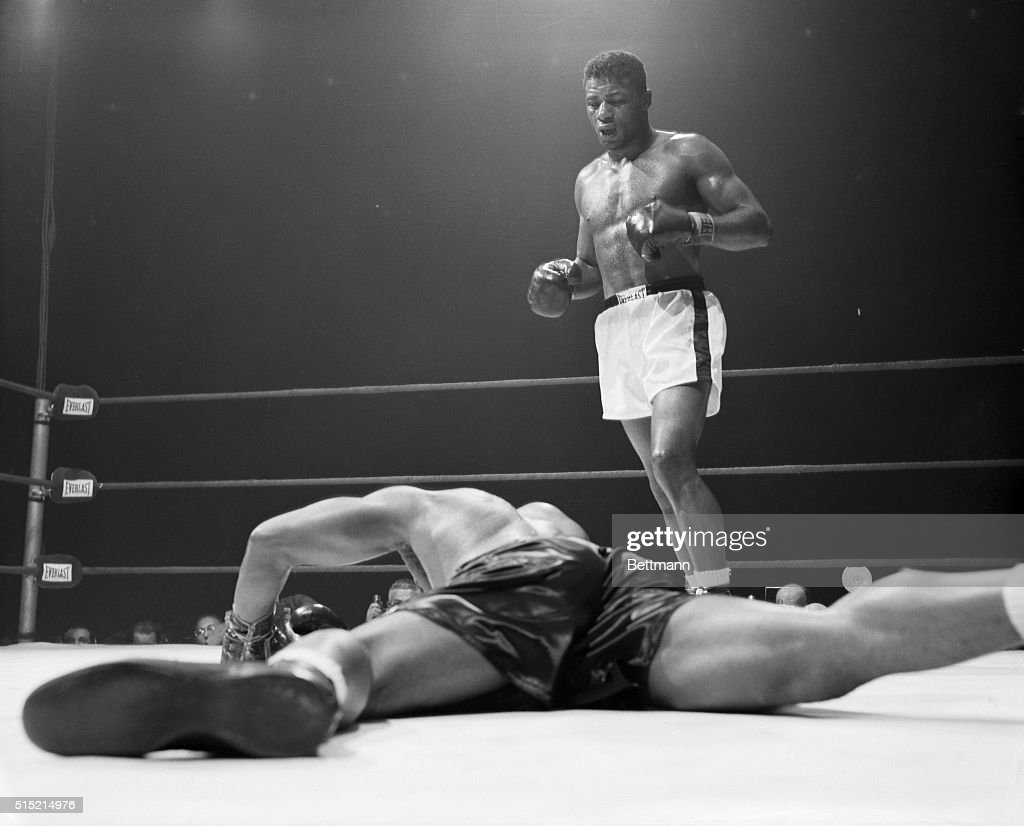 <a gi-track='captionPersonalityLinkClicked' href=/galleries/search?phrase=Archie+Moore&family=editorial&specificpeople=93092 ng-click='$event.stopPropagation()'>Archie Moore</a> decorates the canvas face down after taking a left hook from <a gi-track='captionPersonalityLinkClicked' href=/galleries/search?phrase=Floyd+Patterson&family=editorial&specificpeople=93400 ng-click='$event.stopPropagation()'>Floyd Patterson</a> in the 5th round of their heavyweight title bout. A moment later, at the 2:27 count of the round, Patterson became the youngest heavyweight champion in history by knocking out the aging Moore.