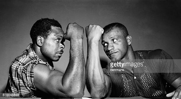 Archie Moore left of San Diego California places his world light heavyweight title on the line for the third time since he won it in 1952 when he...