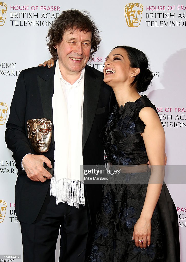 Archie Panjabi and Stephen Rea pose in the winners room with the Best Supporting Actor award at the House of Fraser British Academy Television Awards at Theatre Royal on May 10, 2015 in London, England.