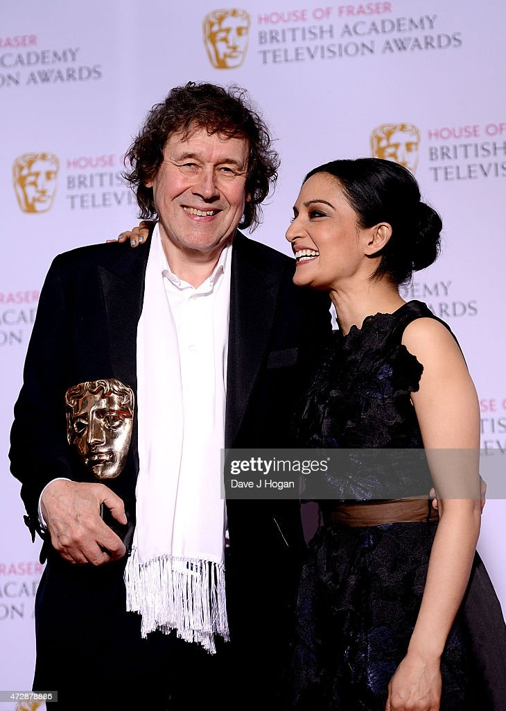 Archie Panjabi and Stephen Rea winner of Best Supporting Actor poses in the winners room at the House of Fraser British Academy Television Awards at Theatre Royal on May 10, 2015 in London, England.