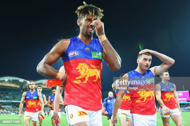 Archie Smith and Tom Rockliff of the Lions looks dejected after defeat during the round 13 AFL match between the Port Adelaide Power and the Brisbane...