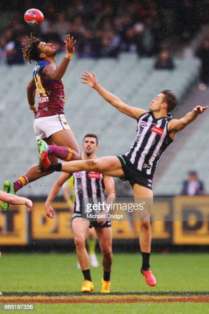 Archie Smith of the Lions and Darcy Moore of the Magpies compete for the ball during the round 10 AFL match between the Collingwood Magpies and...