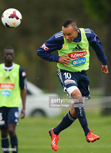 Archie Thompson headers the ball during a Melbourne Victory ALeague training session at Gosch's Paddock on October 10 2013 in Melbourne Australia