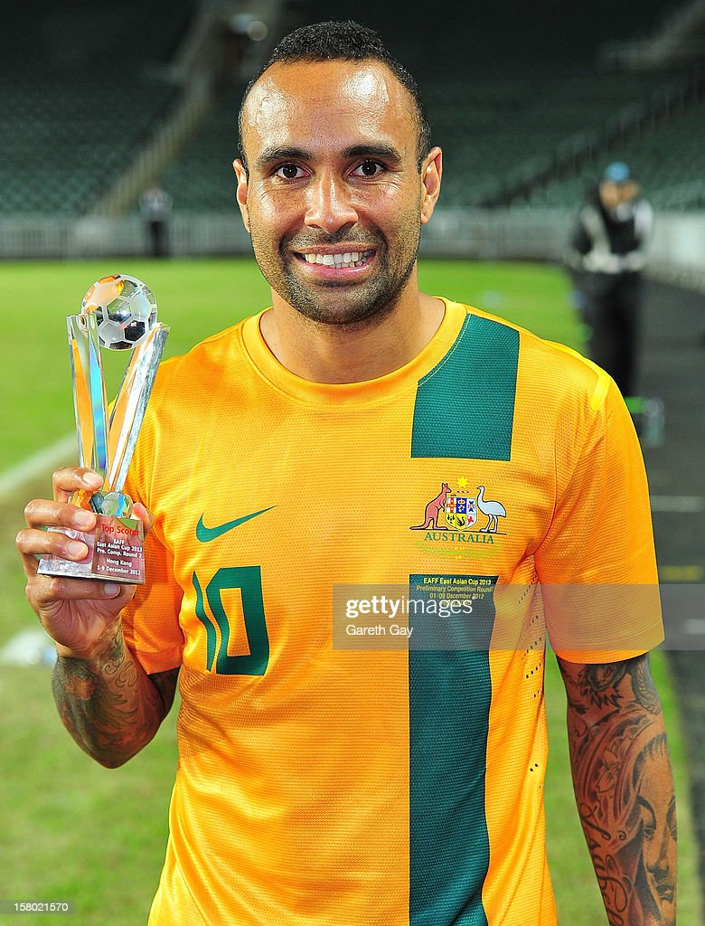 Archie Thompson of Australia poses with the top scorer trophy after the EAFF East Asian Cup 2013 Qualifying match between Chinese Tapei and the Australian Socceroos at Hong Kong Stadium on December 9, 2012 in So Kon Po, Hong Kong. It was later revealed that officials had made a mistake in their calculations, later awarding the accolade to Ri Myong Jun of DPR Korea.