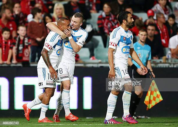 Archie Thompson of Melbourne Victory celebrates with Besart Berisha after scoring a goal during the round 21 ALeague match between the Western Sydney...