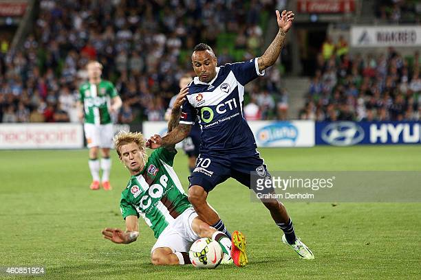 Archie Thompson of Melbourne Victory is challenged during the round 13 ALeague match between the Melbourne Victory and Newcastle Jets at AAMI Park on...