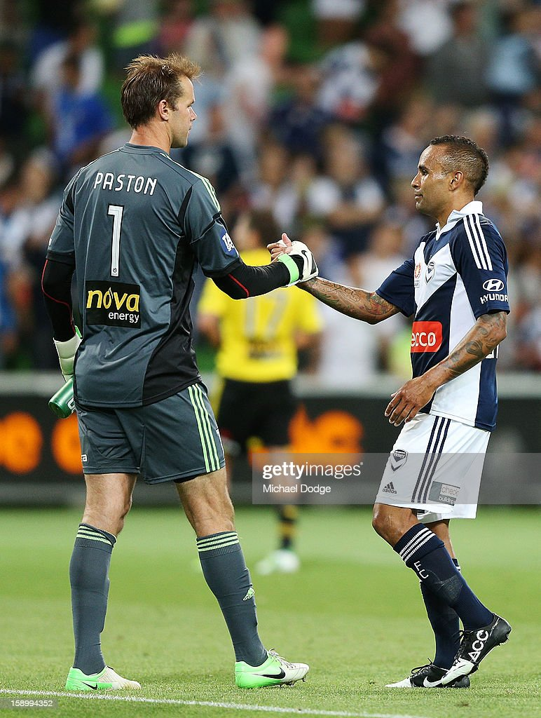 Archie Thompson of the Melbourne Victory (R) shakes hands with goal keeper Mark Paston of the Wellington Phoenix after the round 15 A-League match between the Melbourne Victory and Wellington Phoenix at AAMI Park on January 5, 2013 in Melbourne, Australia.