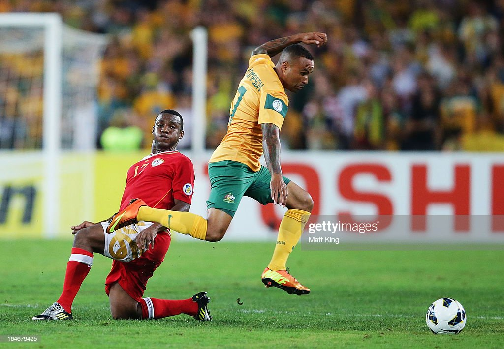 Archie Thompson of the Socceroos gets past Hassan Al Gheilani of Oman during the FIFA 2014 World Cup Qualifier match between the Australian Socceroos and Oman at ANZ Stadium on March 26, 2013 in Sydney, Australia.