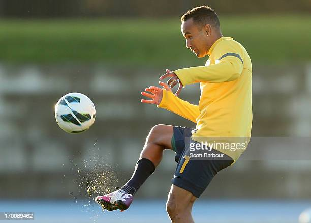 Archie Thompson of the Socceroos kicks the ball during an Australian Socceroos training session at Lakeside Stadium on June 7 2013 in Melbourne...