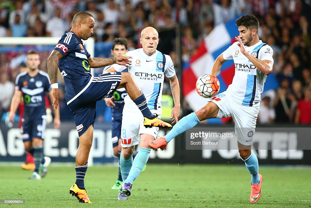 <a gi-track='captionPersonalityLinkClicked' href=/galleries/search?phrase=Archie+Thompson&family=editorial&specificpeople=545649 ng-click='$event.stopPropagation()'>Archie Thompson</a> of the Victory and Paulo Retre of City FC compete for the ball during the round 19 A-League match between Melbourne City FC and Melbourne Victory at AAMI Park on February 13, 2016 in Melbourne, Australia.