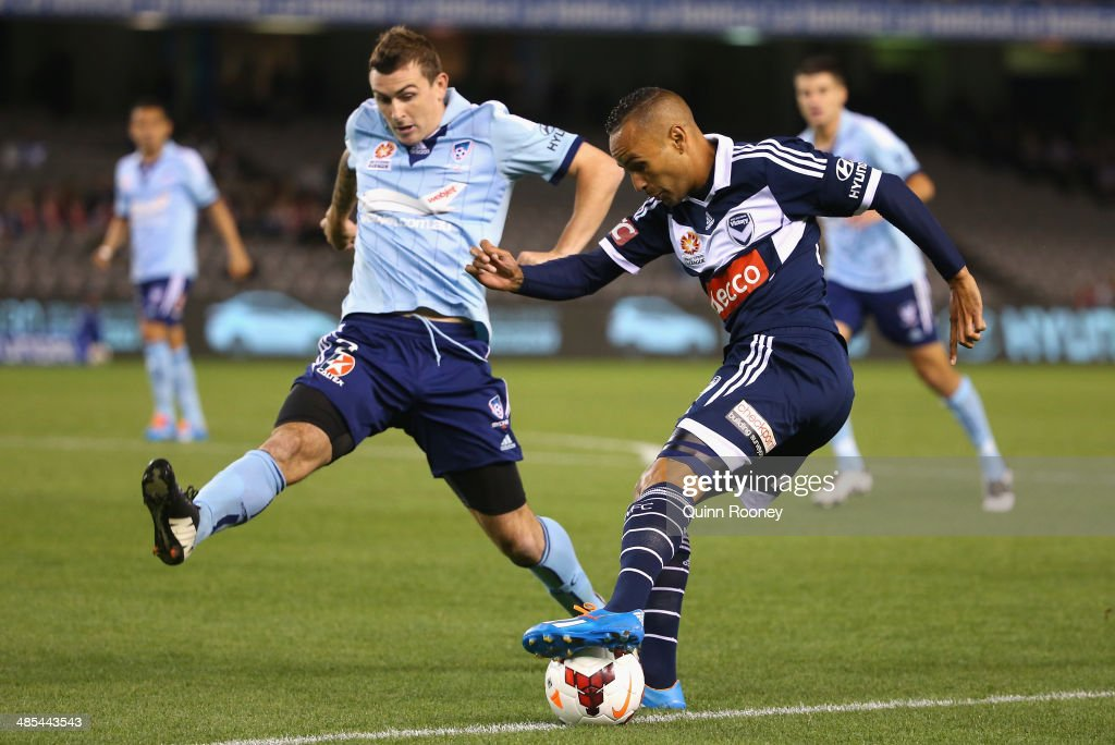 Archie Thompson of the Victory and Sebastian Ryall of Sydney contest for the ball during the ALeague Elimination Final match between the Melbourne...