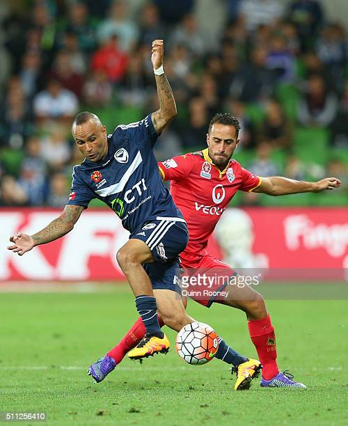 Archie Thompson of the Victory and Tarek Elrich of United competes for the ball during the round 20 ALeague match between Melbourne Victory and...