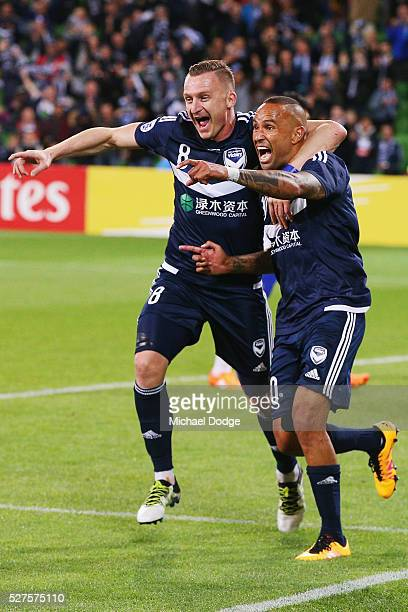 Archie Thompson of the Victory celebrates a goal with Besart Berisha during the AFC Champions League match between Melbourne Victory and Gamba Osaka...