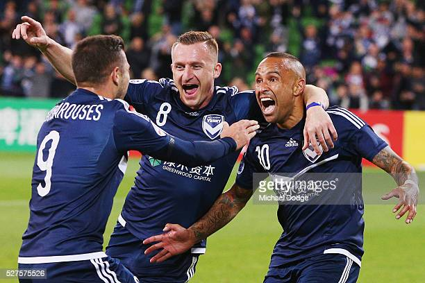 Archie Thompson of the Victory celebrates a goal with Besart Berisha and Kosta Barbarouses during the AFC Champions League match between Melbourne...