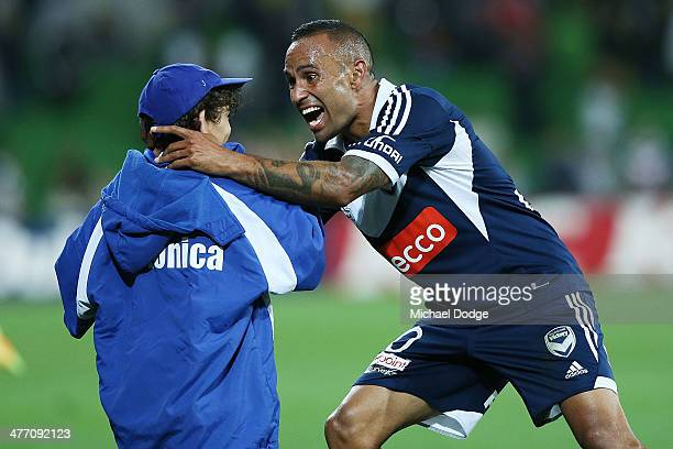 Archie Thompson of the Victory celebrates a team goal by by kissing his Axel Thompson during the round 22 ALeague match between Melbourne Victory and...