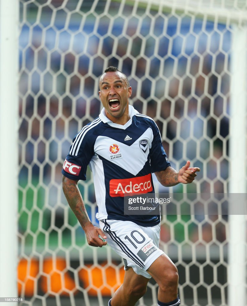 Archie Thompson of the Victory celebrates after he scored his teams second goal during the round 13 A-League match between the Melbourne Victory and the Newcastle Jets at AAMI Park on December 28, 2012 in Melbourne, Australia.