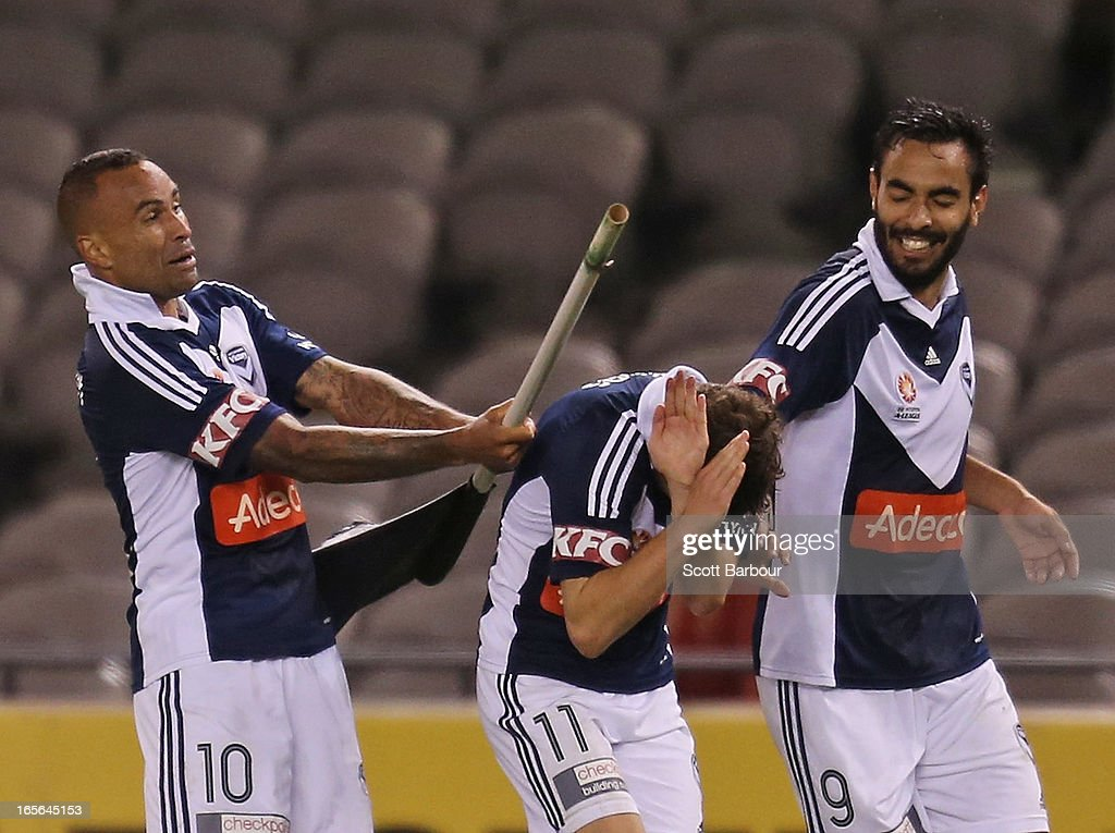<a gi-track='captionPersonalityLinkClicked' href=/galleries/search?phrase=Archie+Thompson&family=editorial&specificpeople=545649 ng-click='$event.stopPropagation()'>Archie Thompson</a> of the Victory celebrates after scoring his teams second goal by swinging the corner post and accidentally hitting team mate Marco Rojas during the A-League Elimination final match between the Melbourne Victory and Perth Glory at Etihad Stadium on April 5, 2013 in Melbourne, Australia.