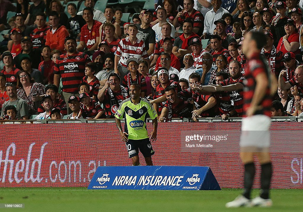 Archie Thompson of the Victory celebrates in front of Wanderers fans after scoring during the round eight A-League match between the Western Sydney Wanderers and the Melbourne Victory at Parramatta Stadium on November 24, 2012 in Sydney, Australia.