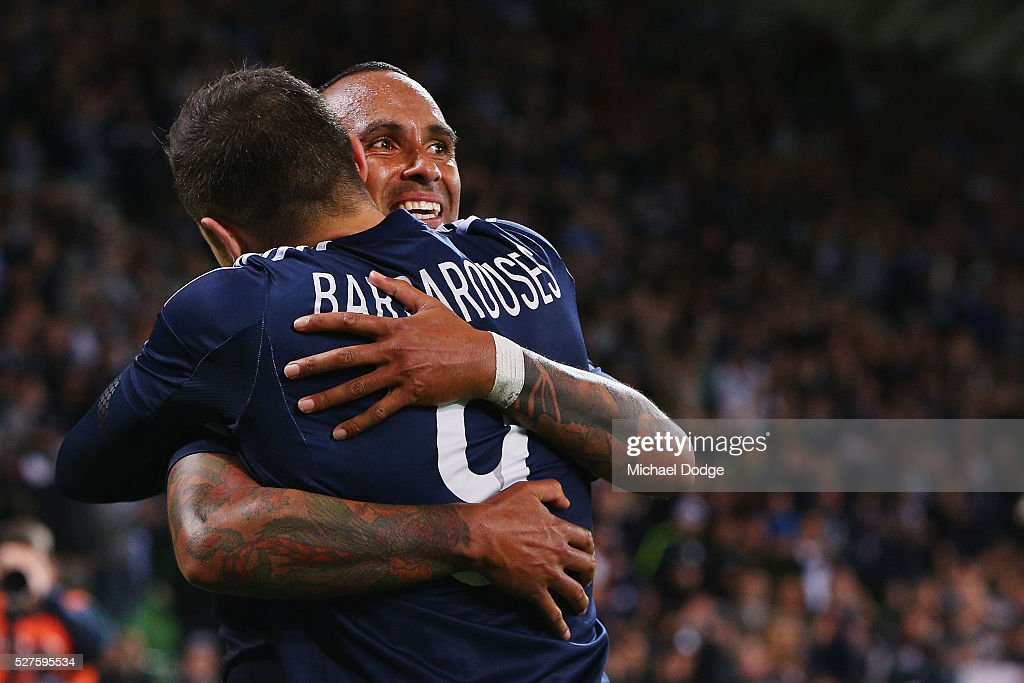 <a gi-track='captionPersonalityLinkClicked' href=/galleries/search?phrase=Archie+Thompson&family=editorial&specificpeople=545649 ng-click='$event.stopPropagation()'>Archie Thompson</a> of the Victory celebrates the win with <a gi-track='captionPersonalityLinkClicked' href=/galleries/search?phrase=Kosta+Barbarouses&family=editorial&specificpeople=7096594 ng-click='$event.stopPropagation()'>Kosta Barbarouses</a> (L) during the AFC Champions League match between Melbourne Victory and Gamba Osaka at AAMI Park on May 3, 2016 in Melbourne, Australia.