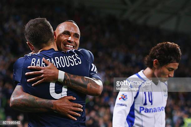 Archie Thompson of the Victory celebrates the win with Kosta Barbarouses during the AFC Champions League match between Melbourne Victory and Gamba...