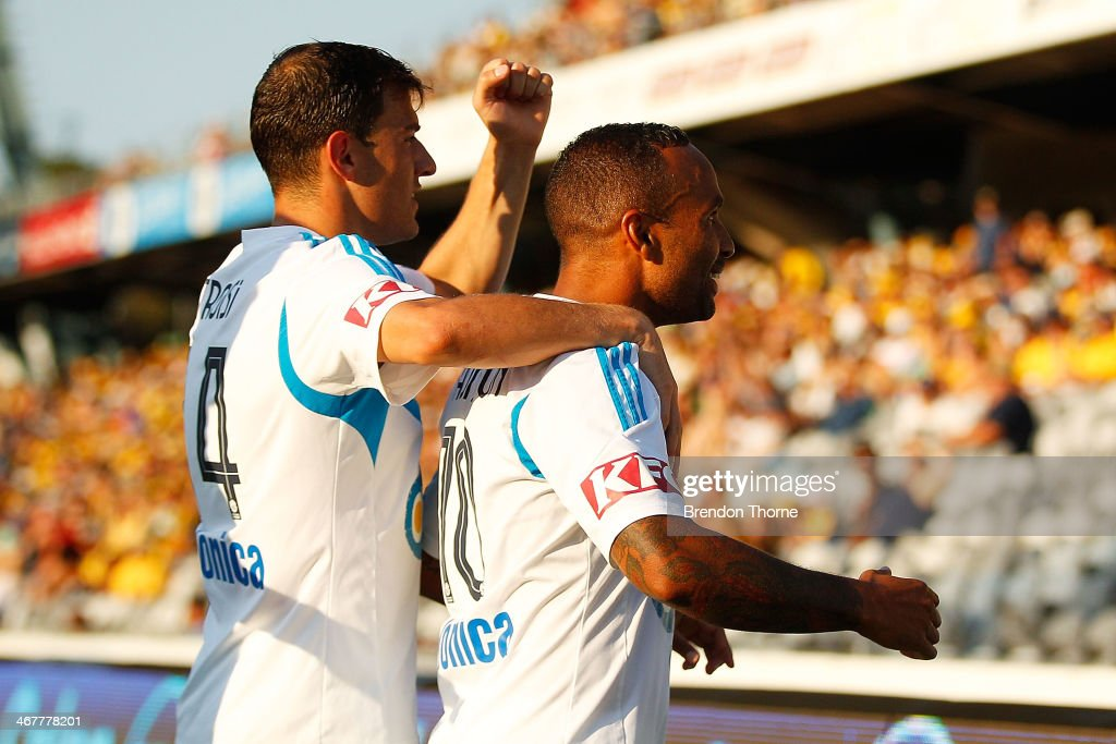 Archie Thompson of the Victory celebrates with team mate James Troisi after scoring during the round 18 ALeague match between the Central Coast...