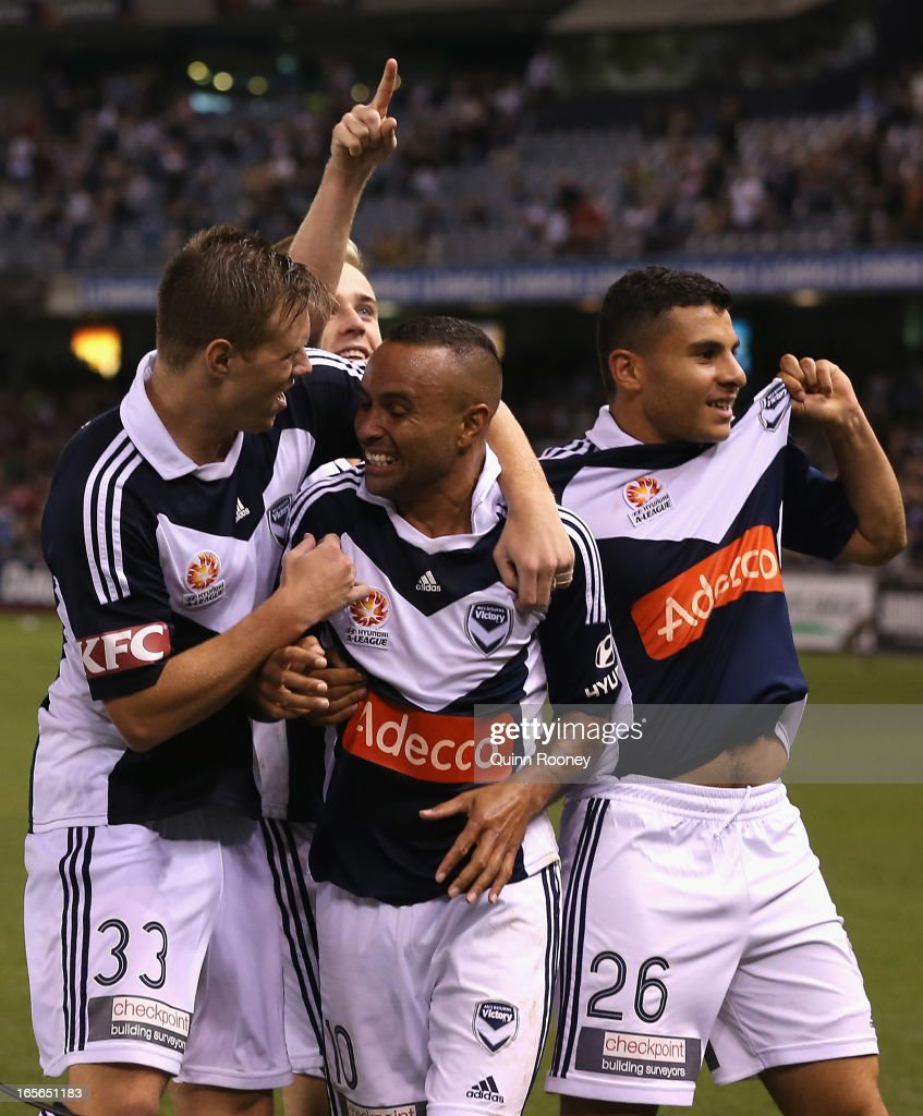 <a gi-track='captionPersonalityLinkClicked' href=/galleries/search?phrase=Archie+Thompson&family=editorial&specificpeople=545649 ng-click='$event.stopPropagation()'>Archie Thompson</a> of the Victory is congratulated by team mates after scoring a goal during the A-League Elimination final match between Melbourne Victory and Perth Glory at Etihad Stadium on April 5, 2013 in Melbourne, Australia.