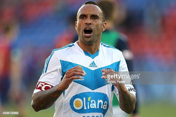 Archie Thompson of the Victory reacts with fans after the round five ALeague match between Newcastle Jets and Melbourne Victory at Hunter Stadium on...