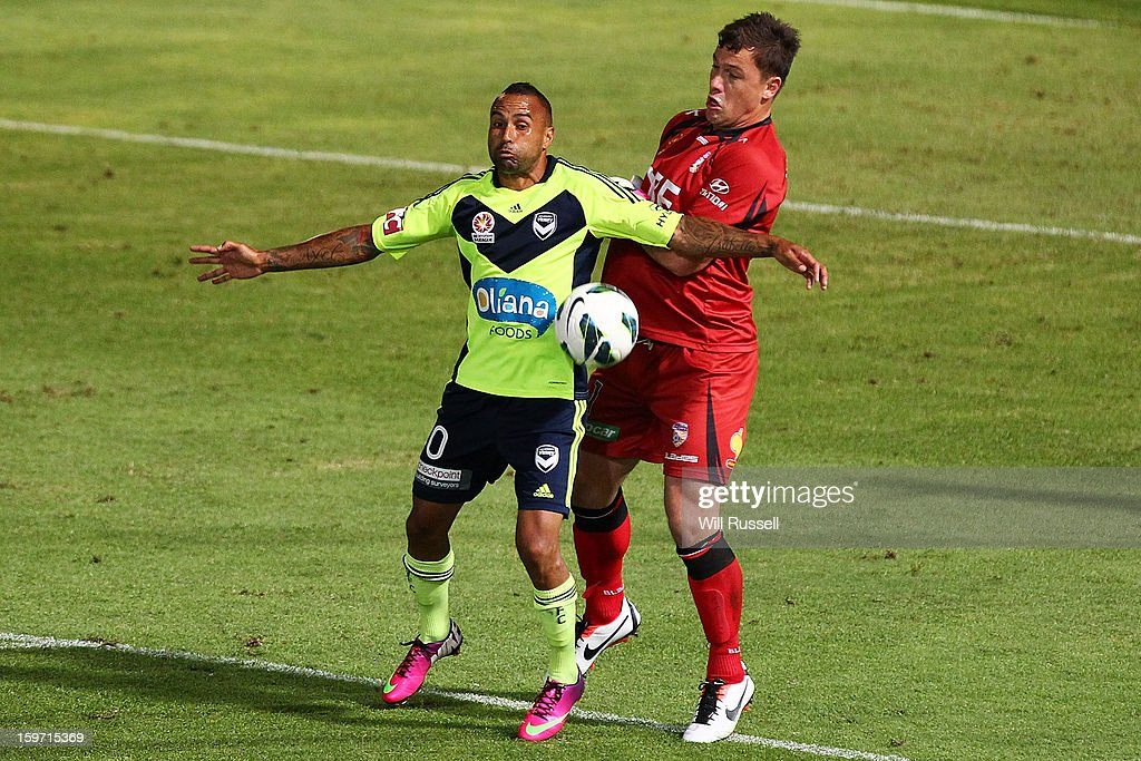 Archie Thompson of the Victory tries to block Daniel Vukovic during the round 17 A-League match between the Perth Glory and the Melbourne Victory at nib Stadium on January 19, 2013 in Perth, Australia.
