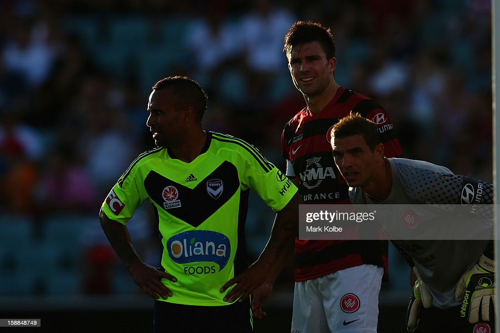 Archie Thompson of the Victory watches on during the round 14 A-League match between the Western Sydney Wanderers and the Melbourne Victory at Parramatta Stadium on January 1, 2013 in Sydney, Australia.