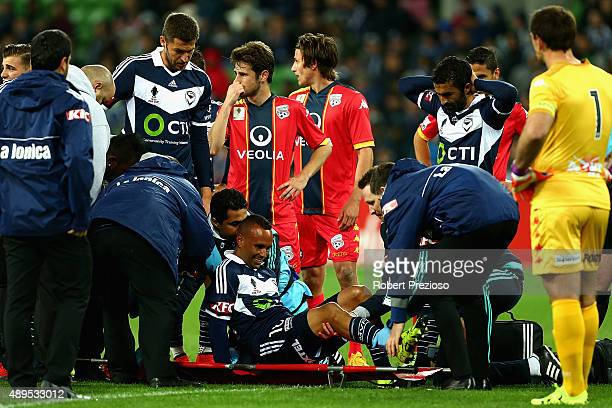 Archie Thompson of Victory receives medical attention during the FFA Cup Quarter Final match between the Melbourne Victory and Adelaide United at...