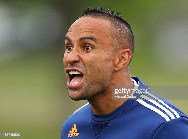 Archie Thompson reacts during a Melbourne Victory ALeague training session at Gosch's Paddock on October 10 2013 in Melbourne Australia