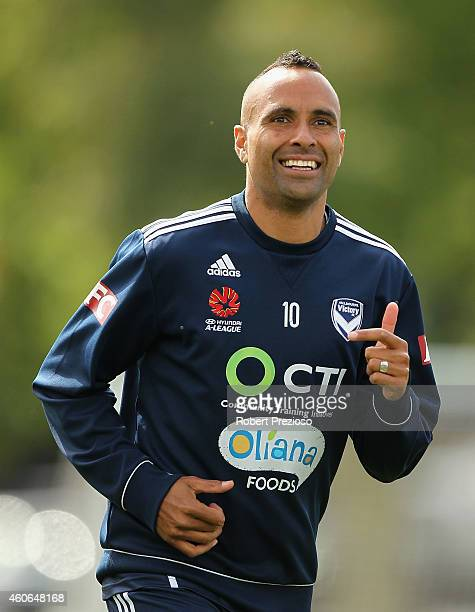 Archie Thompson runs laps with teammates during a Melbourne Victory ALeague training session at Gosch's Paddock on December 19 2014 in Melbourne...