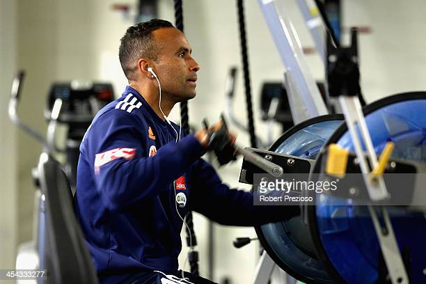 Archie Thompson warms up during a Melbourne Victory ALeague recovery session at AAMI Park on December 9 2013 in Melbourne Australia