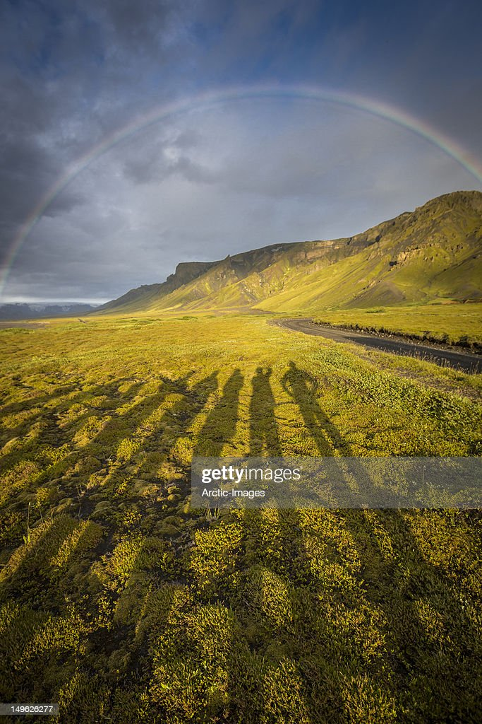 Arching rainbow and shadows : Stock Photo