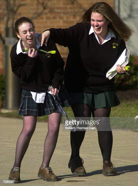 Archishop Wood Catholic High Scool students Jessica Jervis and Jessica Pacek laugh at the end of a school day March 21 2002 in Warminster PA In the...