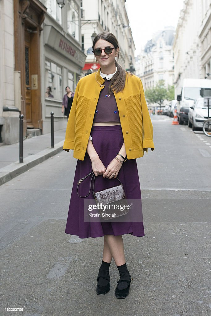 Architect Alexandra Dominic wears a Falke skirt, own design top, Prada shoes, vintage sunglasses and cardigan and a Mulberry bag on day 5 of Paris Fashion Week Spring/Summer 2014, Paris September 28, 2013 in Paris, France.